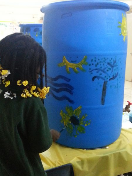 Student gardener painting a beautiful sunflower.