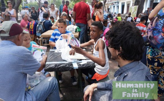 Passing out art kits on Paseo del Prado to the Cuban children